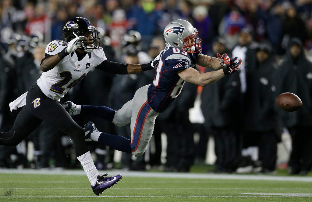 . New England Patriots wide receiver Wes Welker (83) dives while being defended by Baltimore Ravens cornerback Corey Graham (24) during the first half of the NFL football AFC Championship football game in Foxborough, Mass., Sunday, Jan. 20, 2013. The pass was incomplete. (AP Photo/Elise Amendola)