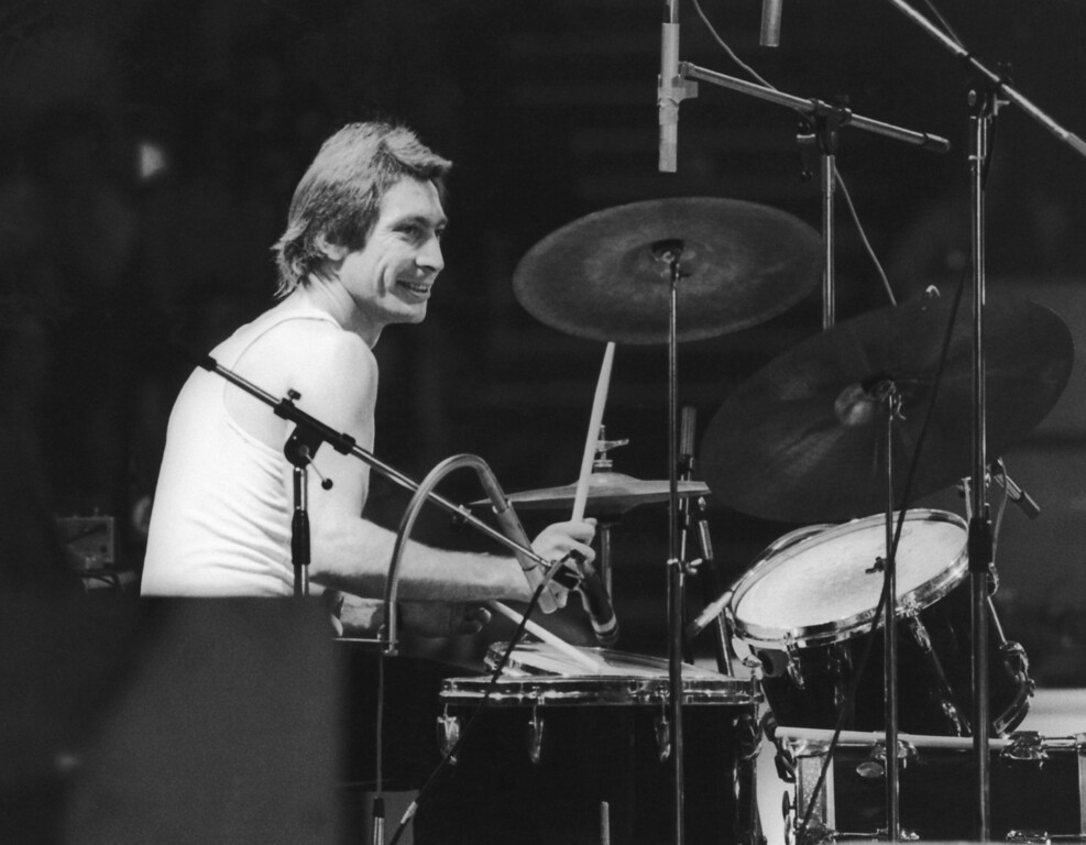 . Drummer Charlie Watts of the Rolling Stones, at a British concert and sporting a new David Bowie style feather cut, 1973. (Photo by Daily Express/Hulton Archive/Getty Images)