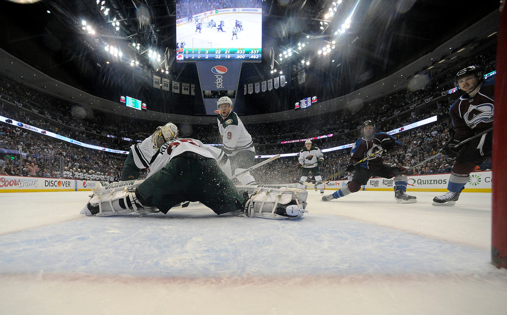 . DENVER, CO - APRIL 26: Colorado Avalanche right wing P.A. Parenteau (15) scored the game tying goal on Minnesota Wild goalie Darcy Kuemper (35) with second left on the clock April 26, 2014 in Game 5 of the Stanley Cup Playoffs at Pepsi Center. (Photo by John Leyba/The Denver Post)