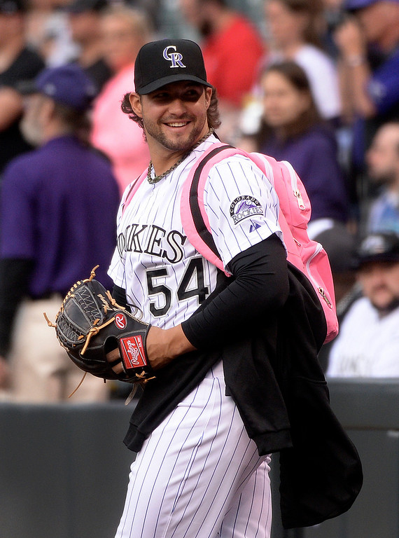 . DENVER, CO - APRIL 18: Colorado reliever Tommy Kahnle wore stylish pink backpack as he headed to the bullpen Friday night. The Colorado Rockies hosted the Philadelphia Phillies Friday night, April 18, 2014 at Coors Field.  (Photo by Karl Gehring/The Denver Post)