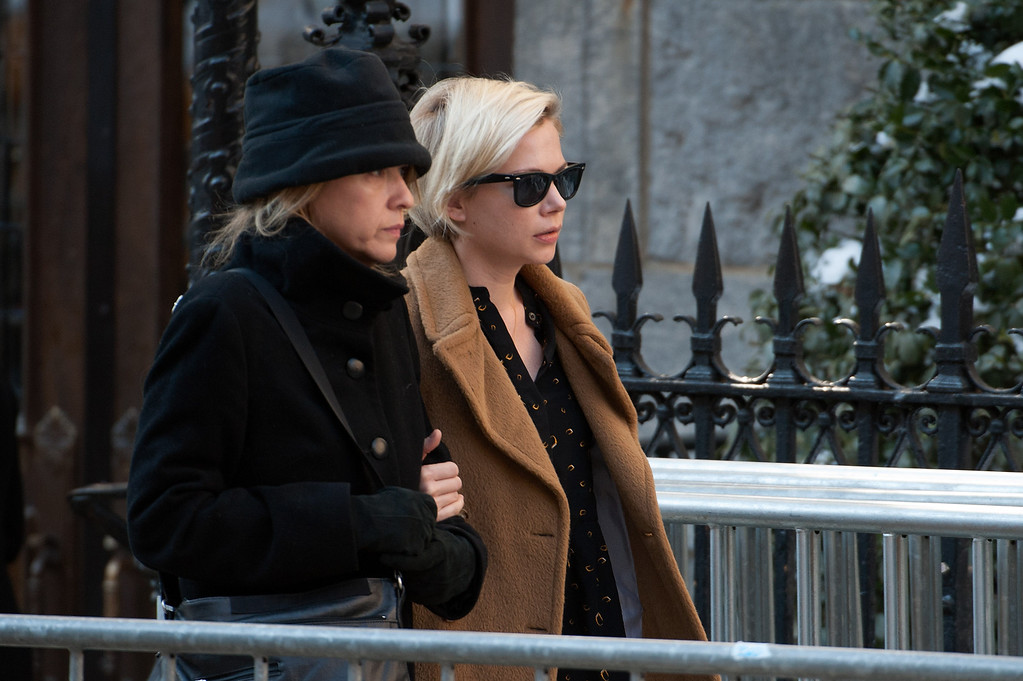. Michelle Williams (R) attends the funeral service for actor Philip Seymour Hoffman at St. Ignatius Of Loyola on February 7, 2014 in New York City. Hoffman died of an alleged drug overdose on February 1, 2014.  (Photo by D Dipasupil/Getty Images)