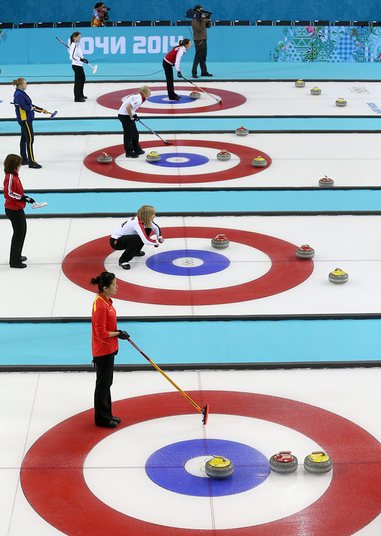 . Captains of teams wait for stones to be delivered during the Round Robin match between China and Canada of the Womens Curling competition in the Ice Cube Curling Center at the Sochi 2014 Olympic Games.  EPA/TATYANA ZENKOVICH