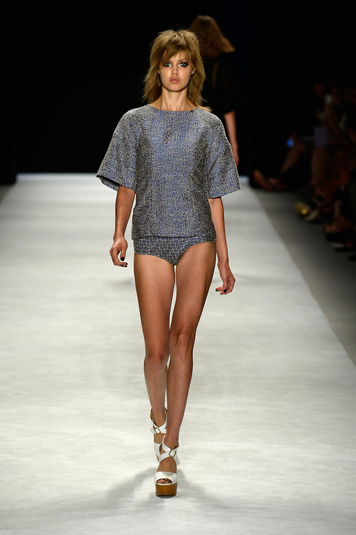 . A model walks the runway at the Jill Stuart fashion show during Mercedes-Benz Fashion Week Spring 2014 at The Stage at Lincoln Center on September 7, 2013 in New York City.  (Photo by Frazer Harrison/Getty Images for Mercedes-Benz Fashion Week Spring 2014)