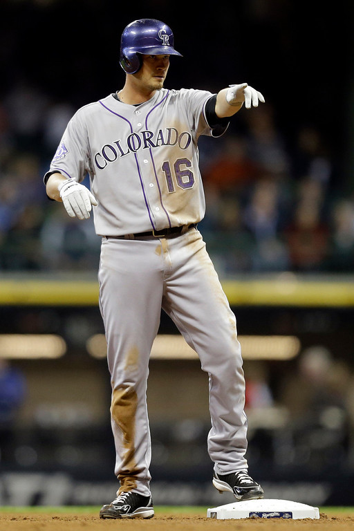 . Colorado Rockies\' Reid Brignac reacts after his RBI double against the Milwaukee Brewers during the fifth inning of a baseball game, Wednesday, April 3, 2013, in Milwaukee. (AP Photo/Jeffrey Phelps)