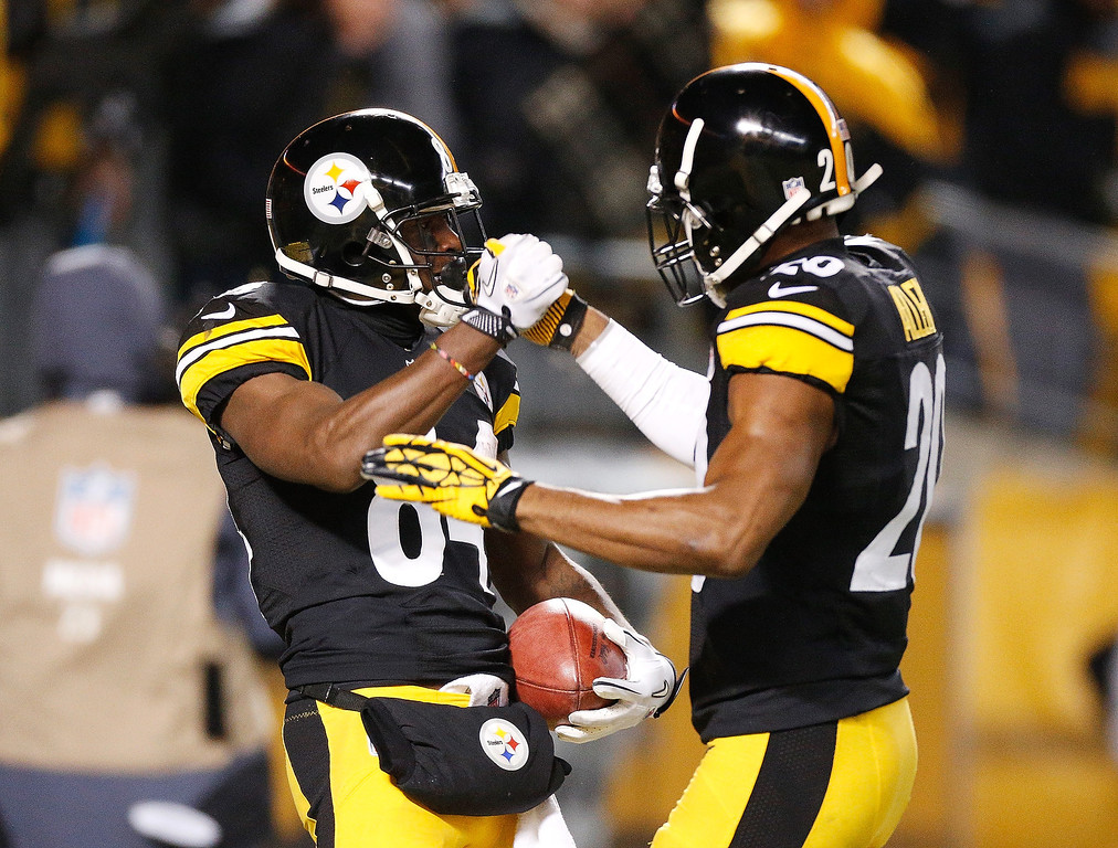 . Antonio Brown #84 of the Pittsburgh Steelers celebrates his first quarter punt return for a touchdown with Will Allen #20 while playing he Cincinnati Bengals at Heinz Field on December 15, 2013 in Pittsburgh, Pennsylvania.  (Photo by Gregory Shamus/Getty Images)
