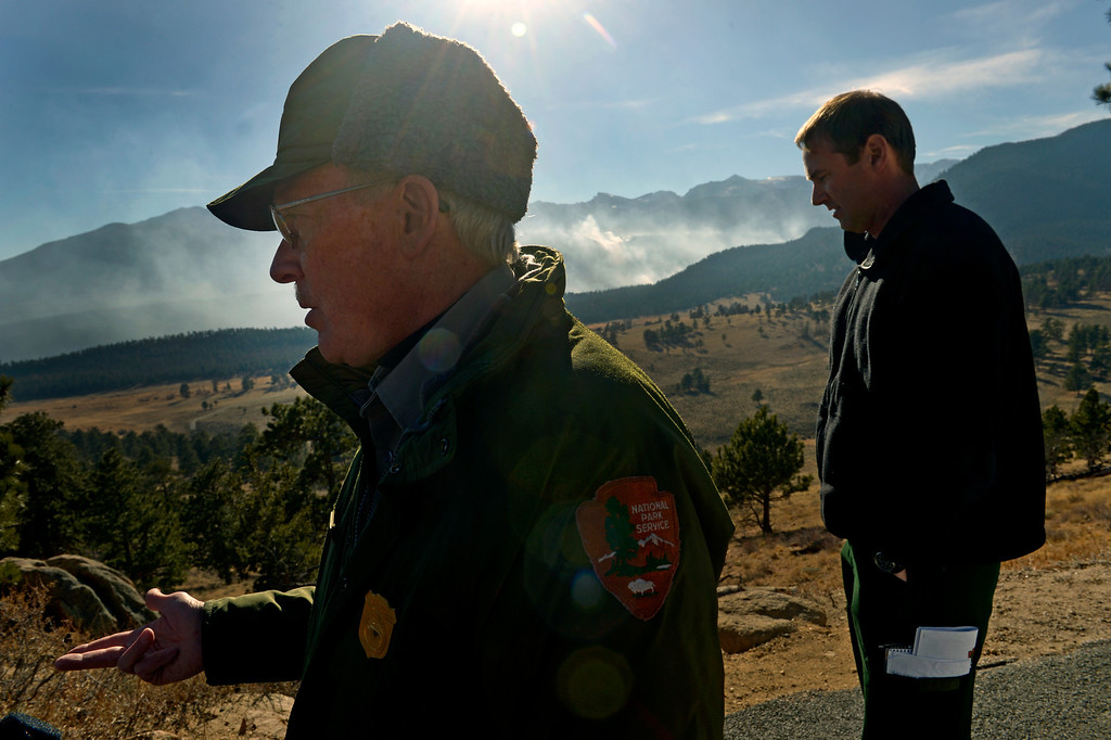 . Larry Frederick, left, and Jake Brollier, Public Information Officers on the Fern Lake Fire, talk about the progress firefighters are making on the fire and the worry about winds kicking up later in the afternoon on December 2, 2012. The Fern Lake Fire, which has been burning in Rocky Mountain National Park since October, kicked up yesterday and forced the evacuation of hundreds of homes east of the fire. Helen H. Richardson, The Denver Post