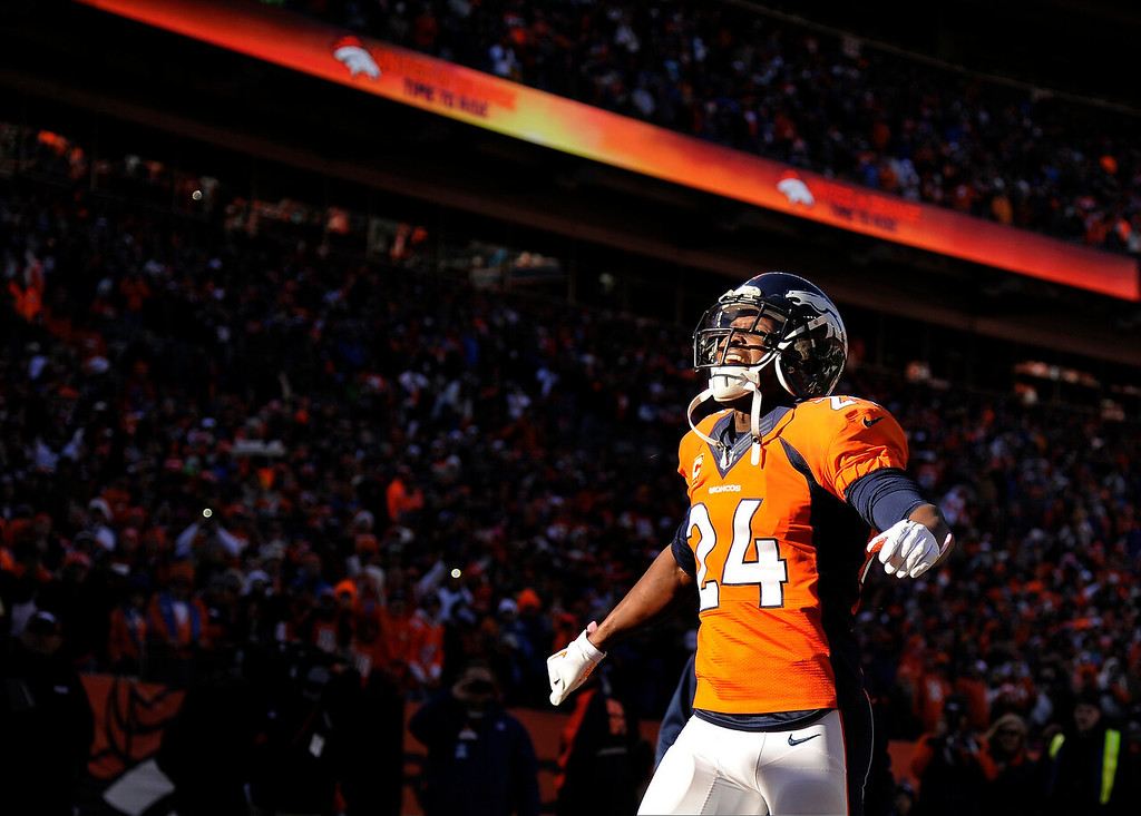 . Denver Broncos cornerback Champ Bailey (24) takes the field. The Denver Broncos vs. The San Diego Chargers in an AFC Divisional Playoff game at Sports Authority Field at Mile High in Denver on January 12, 2014. (Photo by Joe Amon/The Denver Post)
