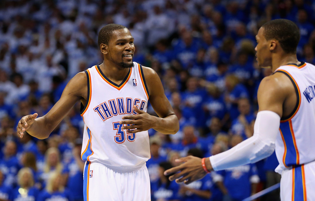 . OKLAHOMA CITY, OK - MAY 27: Kevin Durant #35 and Russell Westbrook #0 of the Oklahoma City Thunder react after a play in the third quarter against the San Antonio Spurs during Game Four of the Western Conference Finals of the 2014 NBA Playoffs at Chesapeake Energy Arena on May 27, 2014 in Oklahoma City, Oklahoma. (Photo by Ronald Martinez/Getty Images)