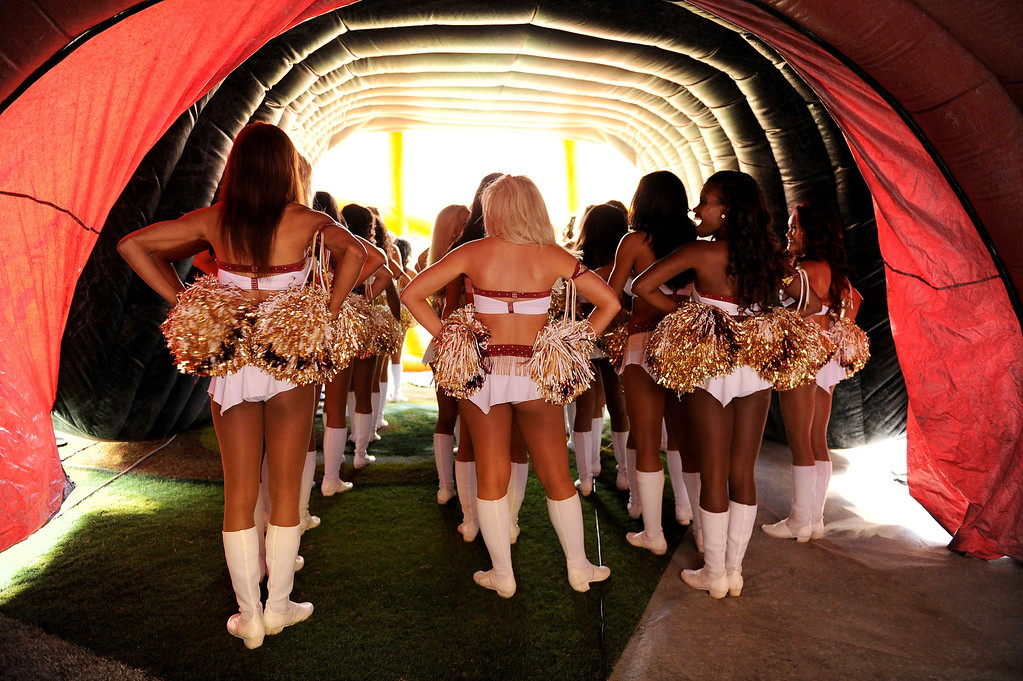 . Washington Redskins cheerleaders wait in the tunnel before running out on the field against the Philadelphia Eagles at FedExField on September 9, 2013 in Landover, Maryland.  (Photo by Patrick Smith/Getty Images)