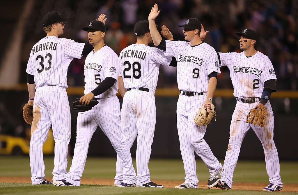 . The Colorado Rockies celebrate their 2-1 victory over the San Francisco Giants at Coors Field on April 22, 2014 in Denver, Colorado.  (Photo by Doug Pensinger/Getty Images)