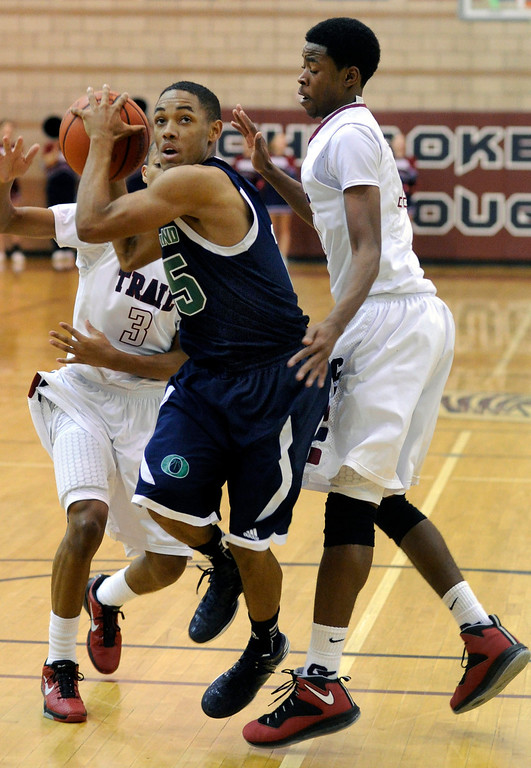 . Overland guard Austin Conway (15) drove the lane in the first half. The Cherokee Trail boy\'s basketball team defeated Overland 59-57 Friday night, January 11, 2013. Karl Gehring/The Denver Post