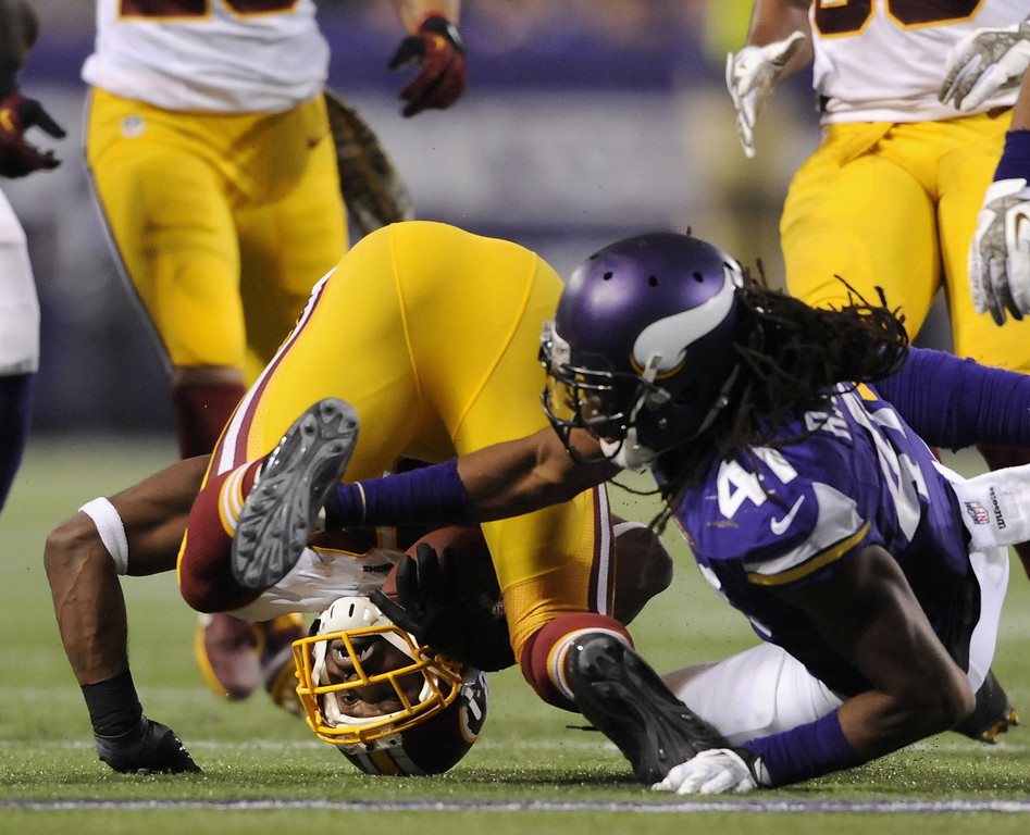 . Mistral Raymond #41 of the Minnesota Vikings tackles Pierre Garcon #88 of the Washington Redskins during the third quarter of the game on November 7, 2013 at Mall of America Field at the Hubert H. Humphrey Metrodome in Minneapolis, Minnesota. (Photo by Hannah Foslien/Getty Images)