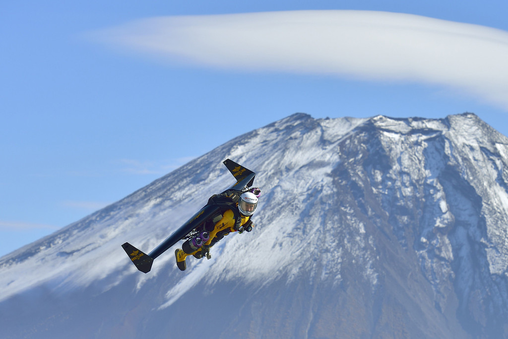 """. This handout picture taken near Fujinomiya in Shizuoka prefecture on November 1, 2013 and released on November 6, 2013 shows Swiss pilot Yves Rossy, or \""""Jetman\"""", flying near Mount Fuji.     AFP PHOTO / Breitling SA & JETMAN PROJECT / KATSUHIKO TOKUNAGA /AFP/Getty Images"""