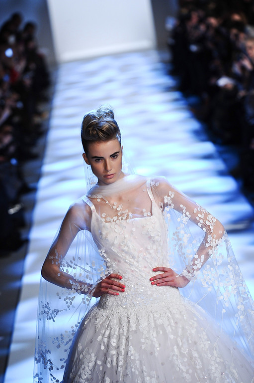 . A model wears a creation by fashion designer Georges Chakra as part of his Spring/Summer 2013 Haute Couture fashion collection, in Paris, Wednesday, Jan. 23, 2013. (AP Photo/Zacharie Scheurer)