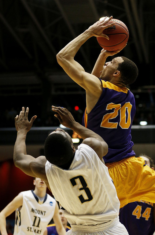 . Gary Johnson #20 of the Albany Great Danes shoots against Sam Prescott #3 of the Mount St. Mary\'s Mountaineers in the first half during the first round of the 2014 NCAA Men\'s Basketball Tournament at at University of Dayton Arena on March 18, 2014 in Dayton, Ohio.  (Photo by Gregory Shamus/Getty Images)