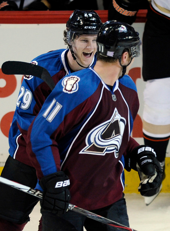 . DENVER, CO. - OCTOBER 02: Avalanche rookie Nathan MacKinnon (29) got his first NHL point by assisting Avs wing Jamie McGinn (11) on his goal in the second period. The Colorado Avalanche hosted the Anaheim Ducks at the Pepsi Center Wednesday night, October 2, 2013. Photo By Karl Gehring/The Denver Post