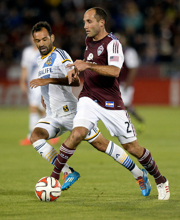 . COMMERCE CITY, CO - MAY 3:  Colorado midfielder Nick LaBrocca (2) controlled the ball in front of Los Angeles midfielder Juninho (19) in the second half. The Colorado Rapids defeated the Los Angeles Galaxy 1-0 Saturday night, May 3, 2014 at Dick\'s Sporting Good Park. (Photo by Karl Gehring/The Denver Post)