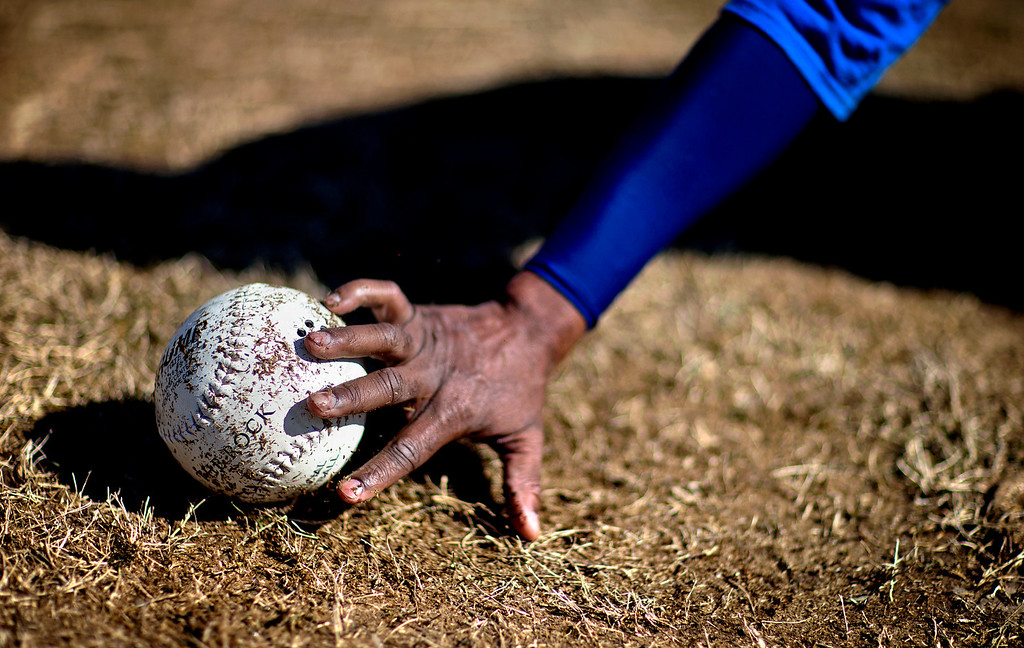 . Jimmie Burnette, who lost his vision to a brain tumor in 2010, reaches for the ball which beeps during a blind baseball workout in Atlanta on April 6, 2013. Players use their sense of sound to make up for their lack of sight. (AP Photo/David Goldman)