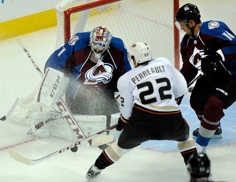 . DENVER, CO. - OCTOBER 02: Anaheim center Mathieu Perreault (22) slapped at a rebound in front of Avs goalie Semyon Valamov (1) in the second period. The Colorado Avalanche hosted the Anaheim Ducks at the Pepsi Center Wednesday night, October 2, 2013. Photo By Karl Gehring/The Denver Post