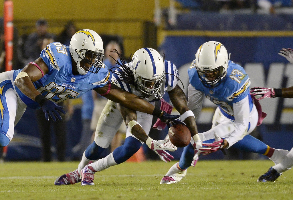 . Greg Toler #28 of the Indianapolis Colts dives for the ball after Antonio Gates #85 of the San Diego Chargers dropped a pass as teammate Keenan Allen #13 defends during the second quarter at Qualcomm Stadium October 14, 2013 in San Diego, California.  (Photo by Kevork Djansezian/Getty Images)