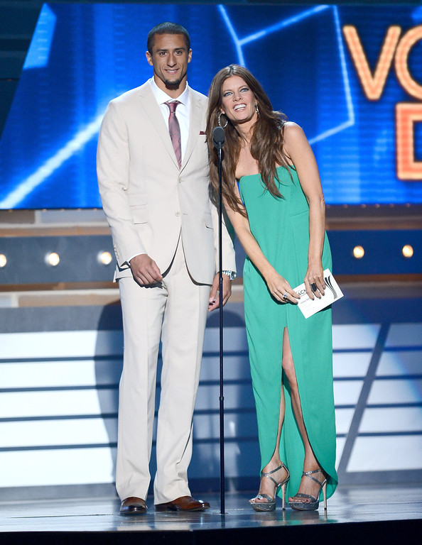 . NFL player Colin Kaepernick (L) and actress Michelle Stafford speak onstage during the 48th Annual Academy of Country Music Awards at the MGM Grand Garden Arena on April 7, 2013 in Las Vegas, Nevada.  (Photo by Ethan Miller/Getty Images)