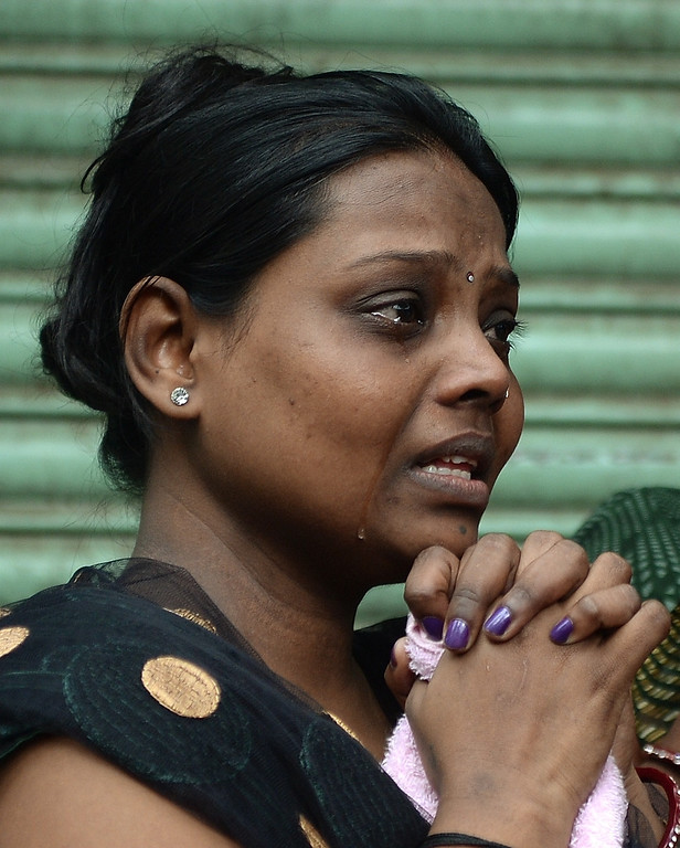 . A relatives cries as she waits near the site of a building collapse in Mumbai on September 27, 2013.   AFP PHOTO/ PUNIT PARANJPE/AFP/Getty Images