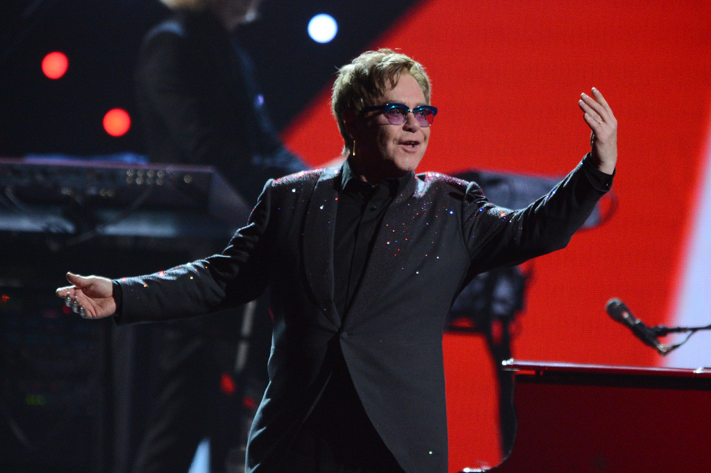 . This Sept. 20, 2013 photo shows Elton John performing at the iHeartRadio Music Festival in Las Vegas, Nev. (Photo by Al Powers/Powers Imagery/Invision/AP)