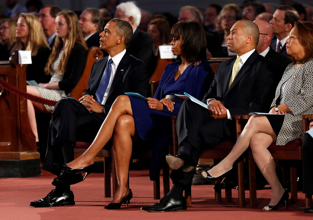 . U.S. President Barack Obama (L) and first lady Michelle Obama (2nd L) attend an interfaith memorial service at the Cathedral of the Holy Cross for the victims of the Boston Marathon bombing in Boston, Massachusetts April 18, 2013.  Massachusetts Governor Deval Patrick sits with the Obamas.  REUTERS/Kevin Lamarque  (