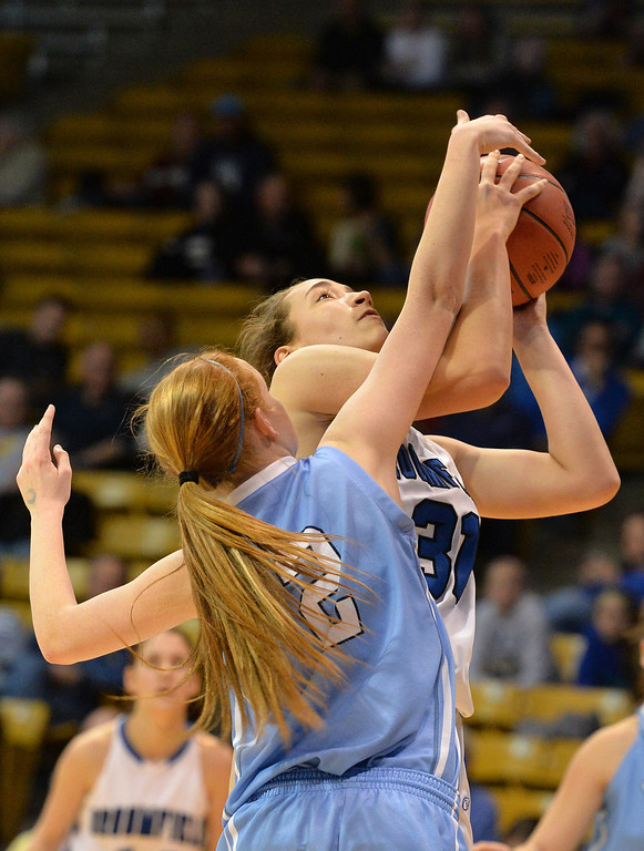 . Broomfield\'s Brenna Fankell goes to the basket  against Valor Christian\'s Madison McCoy during the final four 4A state game at Coors Event Center. (David R. Jennings/Broomfield Enterprise)