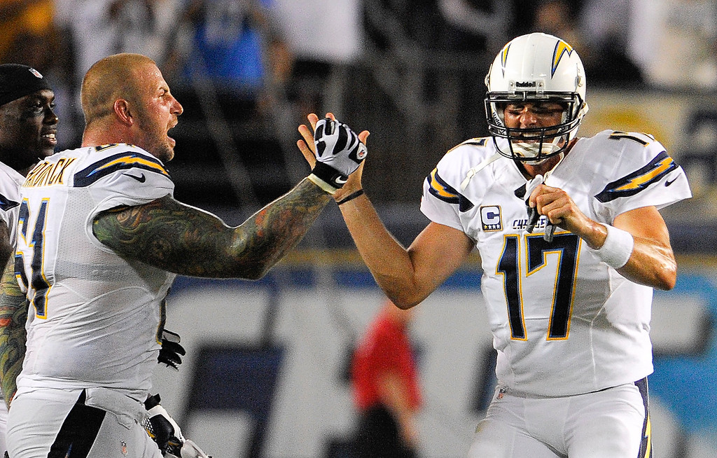. San Diego Chargers quarterback Philip Rivers, right, celebrates a touchdown with Nick Hardwick during the first half of an NFL football game against the Houston Texans Monday, Sept. 9, 2013, in San Diego. (AP Photo/Denis Poroy)