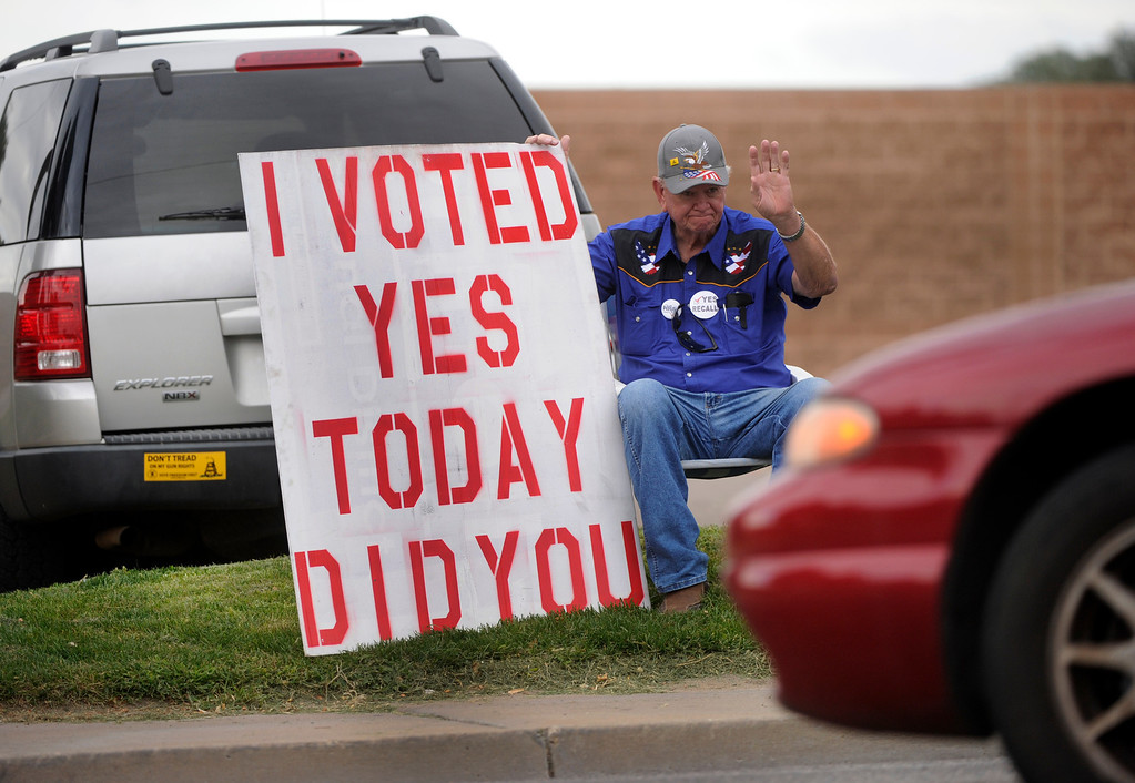 . PUEBLO, CO. - SEPTEMBER 10: National Rifle Association member Ted Bamber waved to passing cars on Prairie Avenue in Pueblo Tuesday afternoon, September 10, 2013. A yes vote indicates support for a recall of State Senator Angelo Giron in District 3. Photo By Karl Gehring/The Denver Post