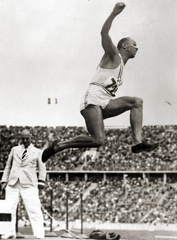 """. James Cleveland \""""Jesse\"""" Owens (September 12, 1913 � March 31, 1980) was an American track and field athlete who specialized in the sprints and the long jump. He participated in the 1936 Summer Olympics in Berlin, Germany, where he achieved international fame by winning four gold medals: one each in the 100 meters, the 200 meters, the long jump, and as part of the 4x100 meter relay team. He was the most successful athlete at the 1936 Summer Olympics.  Jessie Owens competes in the men\'s Olympic Games Long Jump event, in Berlin, Germany, Aug. 5, 1936. (AP Photo)"""