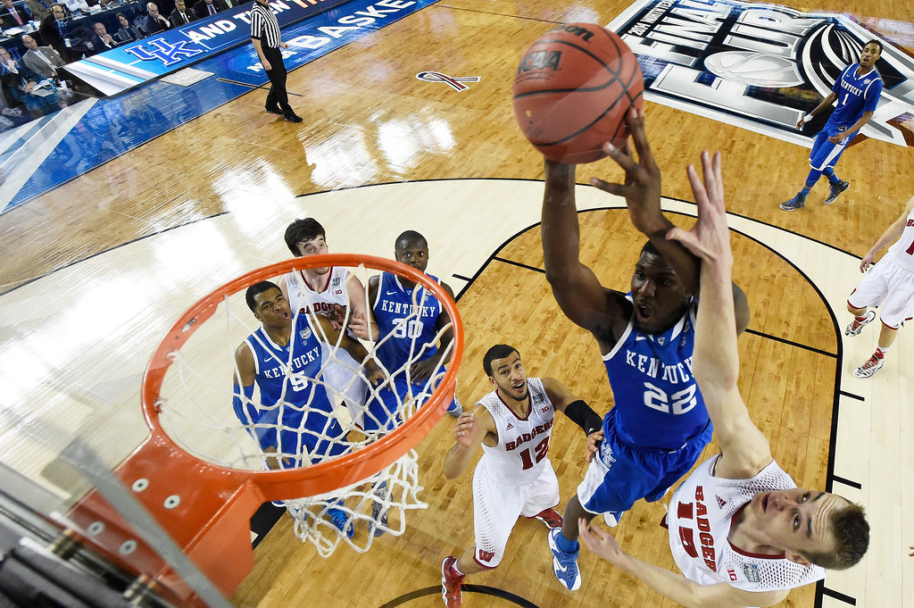 . ARLINGTON, TX - APRIL 05: Alex Poythress #22 of the Kentucky Wildcats goes up for a shot as Sam Dekker #15 of the Wisconsin Badgers defends during the NCAA Men\'s Final Four Semifinal at AT&T Stadium on April 5, 2014 in Arlington, Texas. (Photo by Chris Steppig-Pool/Getty Images)