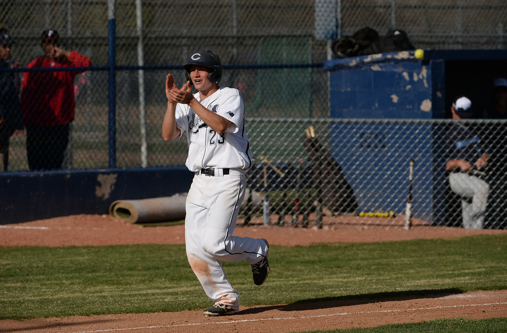 . LITTLETON, CO - APRIL 16,  2014: Columbine Rebels\' Michael Tait, #23, claps as he runs towards home base after the home run hit by Donny Ortiz, #3, in the fourth inning home run with teammates during their game against the Ralston Valley Mustangs at Columbine High School in Littleton, Co on April 17, 2014. Columbine pitcher Blake Weiman had a great game and was taken out in the fifth inning when the Rebels were up 8 to 1 over the Mustangs. (Photo By Helen H. Richardson/ The Denver Post) 12