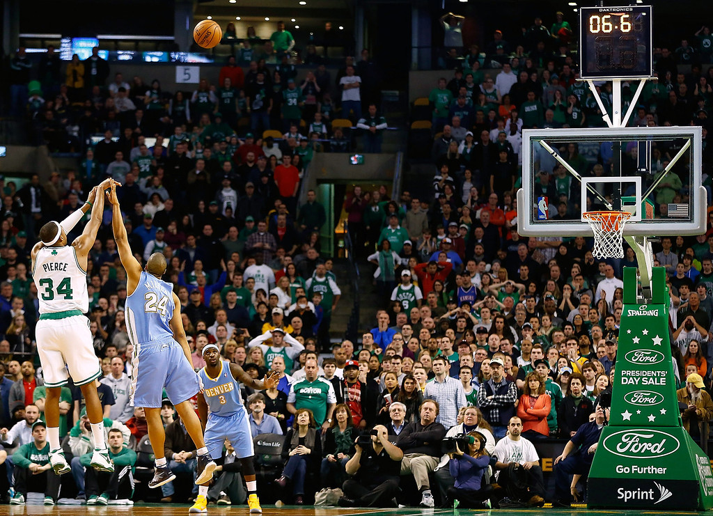 . BOSTON, MA - FEBRUARY 10: Paul Pierce #34 of the Boston Celtics shoots a three-point shot to tie the game and take it into a third overtime over Andre Miller #24 of the Denver Nuggets during the game on February 10, 2013 at TD Garden in Boston, Massachusetts.  (Photo by Jared Wickerham/Getty Images)