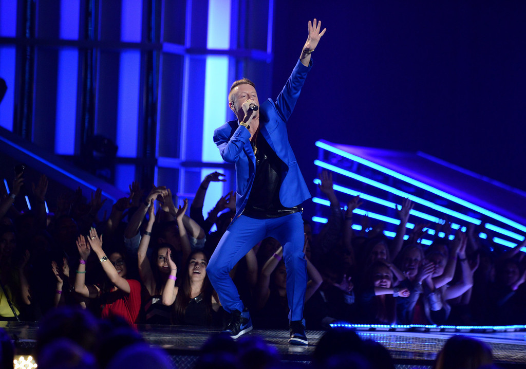 . Rapper Macklemore performs at the MTV Movie Awards in Sony Pictures Studio Lot in Culver City, Calif., on Sunday April 14, 2013. (Photo by Jordan Strauss/Invision for MTV/AP Images)