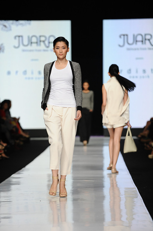 . A model showcases designs by Ardistia New York at the Juara show on the runway during Jakarta Fashion Week 2014 at Senayan City on October 21, 2013 in Jakarta, Indonesia.  (Photo by Robertus Pudyanto/Getty Images)