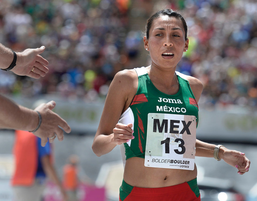 . Team Mexico\'s Marisol Guadalupe Romero Rosal crosses the finish line 8th in the women\'s elite race during the Bolder Boulder on Monday, May 27, in Boulder.  Jeremy Papasso/Camera