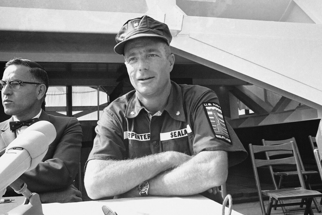 . M. Scott Carpenter, a member of America\'s first group of astronauts, is now a member of the country\'s first team of aquanauts. He and nine fellow members of the team were introduced at Long Beach, California on July 23, 1965 where he is shown during a press conference at which he said he was taking part in experiments in living for extended periods under water because of similarities between investigations of space and ocean. (AP Photo/ERB)