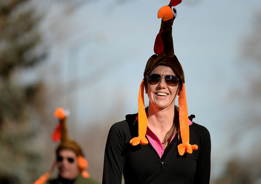 . Martha Dwight with a Turkey hat in the 40th Annual Turkey Trot in Washington Park in Denver, Colorado on November 28, 2013. Denver\'s largest Thanksgiving Day run benefits United Way and goes for 4 miles. (Photo by Hyoung Chang/The Denver Post)