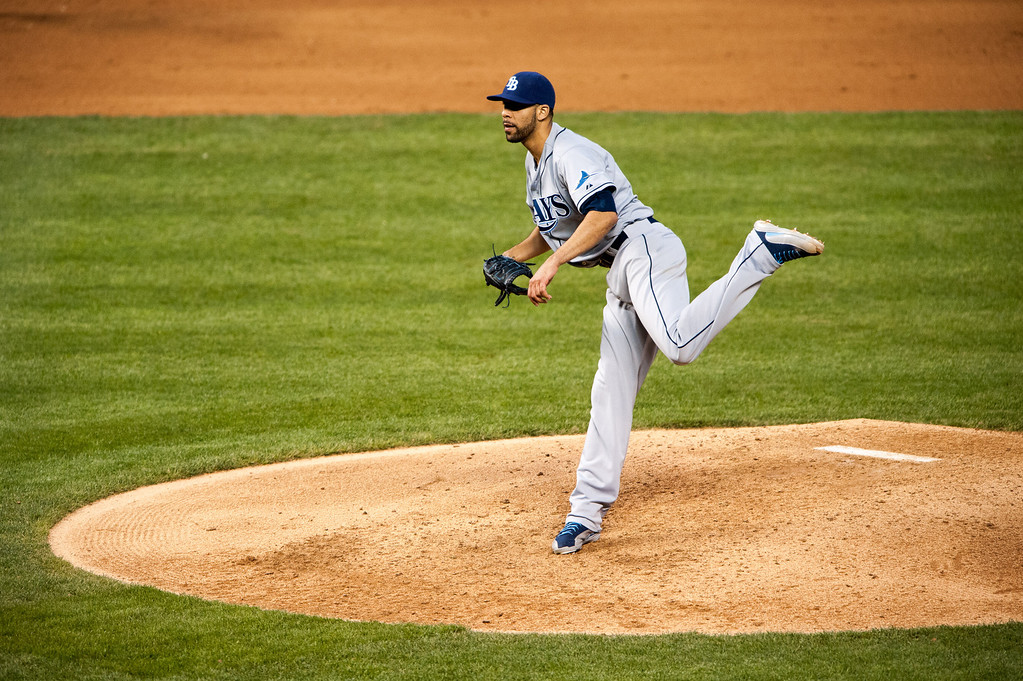 . DENVER, CO - MAY 4:  David Price #14 of the Tampa Bay Rays follows through on a pitch against the Colorado Rockies at Coors Field on May 4, 2013 in Denver, Colorado.  (Photo by Dustin Bradford/Getty Images)