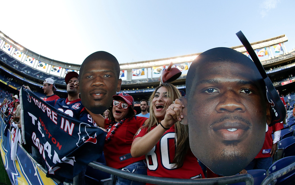 . Houston Texans fans cheers doing warm ups before in an NFL football game against the San Diego Chargers Monday, Sept. 9, 2013, in San Diego. (AP Photo/Gregory Bull)