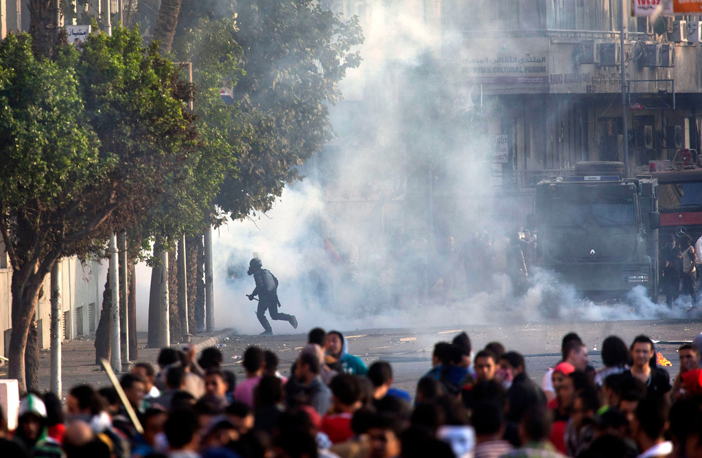 . Egyptian protesters clash with riot police in downtown Cairo, Egypt, Saturday, March 9, 2013. Security officials say a protester has died during clashes between police and hundreds of stone-throwing demonstrators in central Cairo.(AP Photo/Nasser Nasser)