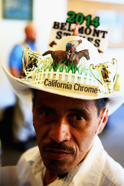 . ELMONT, NY - JUNE 07:  A fan wears a hat prior to the Belmont Stakes at Belmont Park on June 7, 2014 in Elmont, New York.  (Photo by Streeter Lecka/Getty Images)