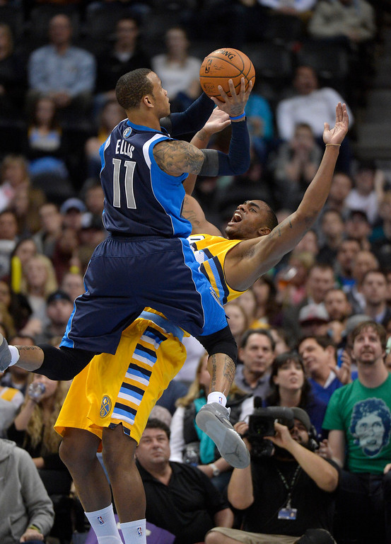 . Denver Nuggets power forward Darrell Arthur (00) draws the offensive foul on Dallas Mavericks shooting guard Monta Ellis (11) during the second quarter  March 5, 2014 at Pepsi Center. (Photo by John Leyba/The Denver Post)