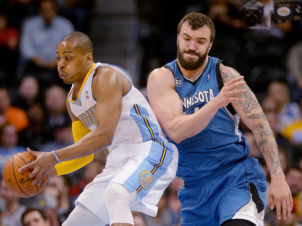 . Randy Foye (4) of the Denver Nuggets steals a rebound from Nikola Pekovic (14) of the Minnesota Timberwolves during the first quarter at the Pepsi Center on Monday, March 3, 2014. (Photo By AAron Ontiveroz/The Denver Post)