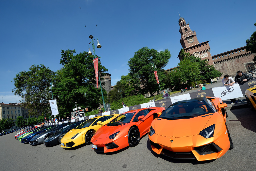 . Lamborghini sports are parked on May 7, 2013 in front of Milan\'s Sforza castle in Milan on the eve of the first leg of a 1,200km Grand Tour through Italy to mark the 50th anniversary of the carmaker. Over 1,200 km of Italian countryside will form the backdrop for hundreds of Lamborghinis, from unforgettable historic GTs to the latest futuristic supercars, which will arrive from every part of the globe and parade through the most beautiful cities in Italy until May 11 when they will reach their final destination, Bologna.  OLIVIER MORIN/AFP/Getty Images