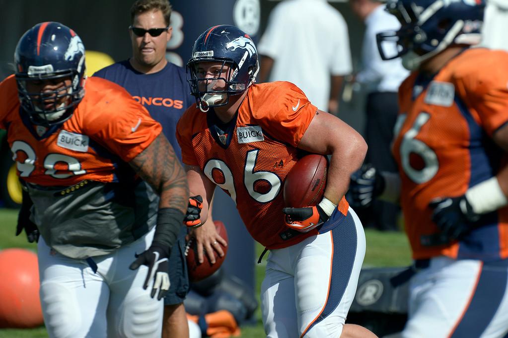 . Denver Broncos DT Mitch Unrein (96) runs through drills during training camp August 6, 2013 at Dove Valley. (Photo By John Leyba/The Denver Post)