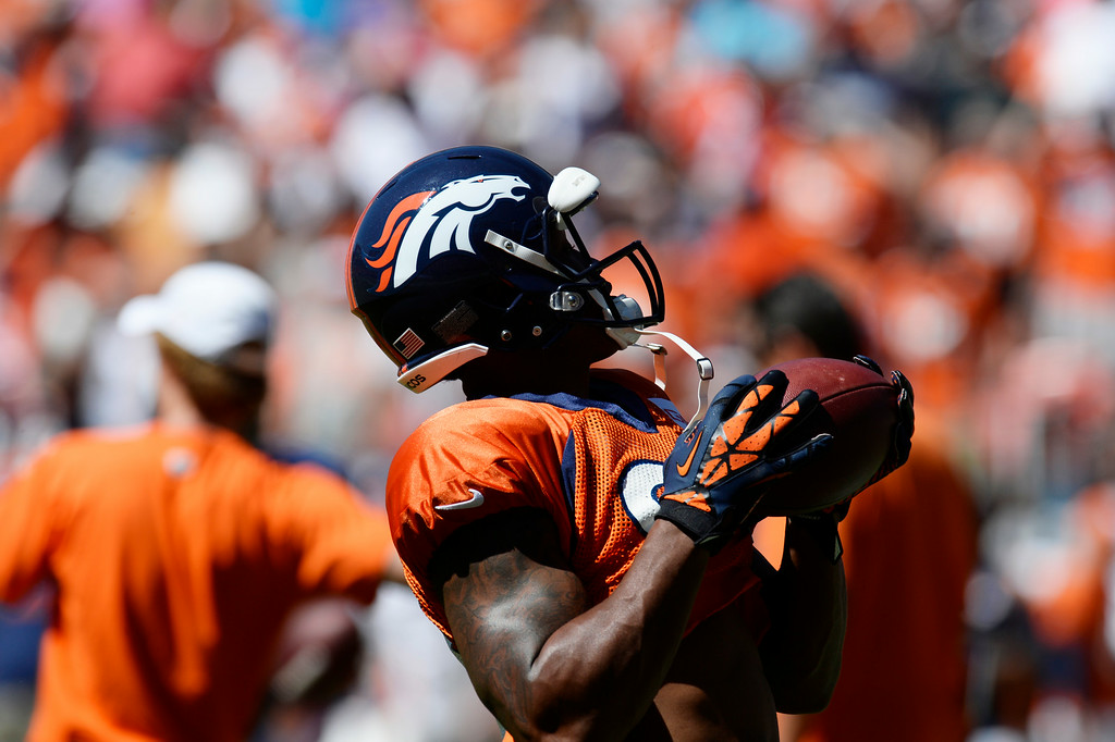 . Denver Broncos WR, Demaryius Thomas, makes a one-handed catch during  practice at Sports Authority Field at Mile High Saturday afternoon, August 02, 2014. (Photo By Andy Cross / The Denver Post)