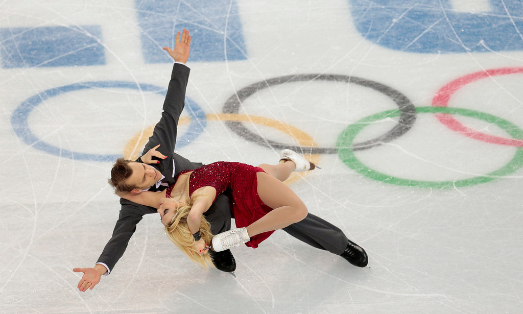. Isabella Tobias and Deividas Stagniunas of Lithuania compete in the ice dance free dance figure skating finals at the Iceberg Skating Palace during the 2014 Winter Olympics, Monday, Feb. 17, 2014, in Sochi, Russia. (AP Photo/Ivan Sekretarev)